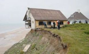 house-falling-off-cliff