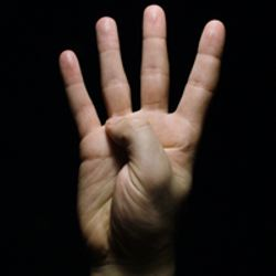 Man-holding-up-four-fingers